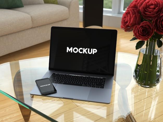 Ноутбук и мобильный телефон на стеклянном столе макет дизайна