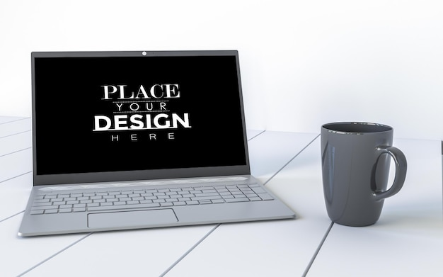 ワークスペースのモックアップの机の上のラップトップとマグカップ