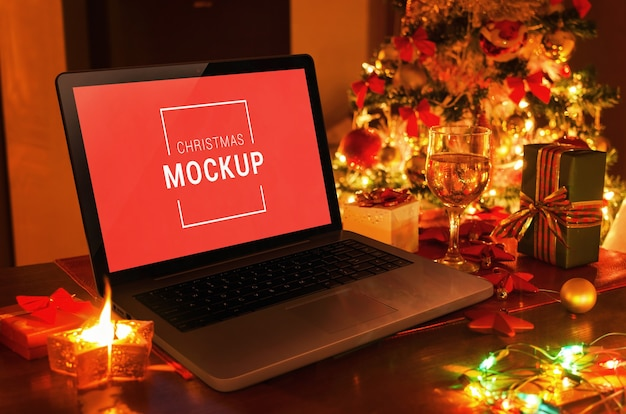 Laptop christmas mockup on desk with gifts and decorations