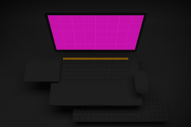 黒い部屋にモックアップ画面を持つラップトップコンピューター