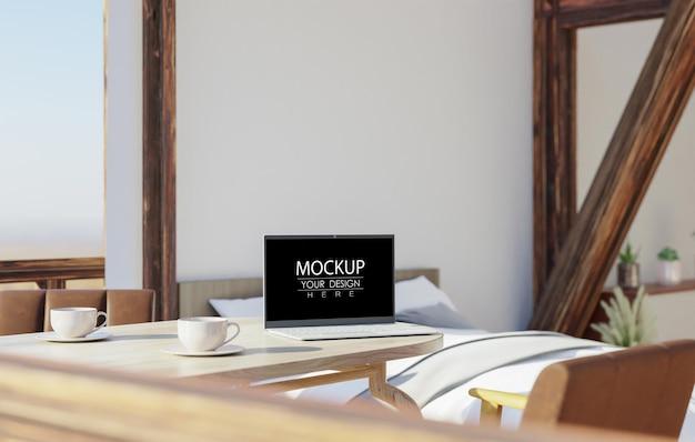 Laptop on desk in work space mockup