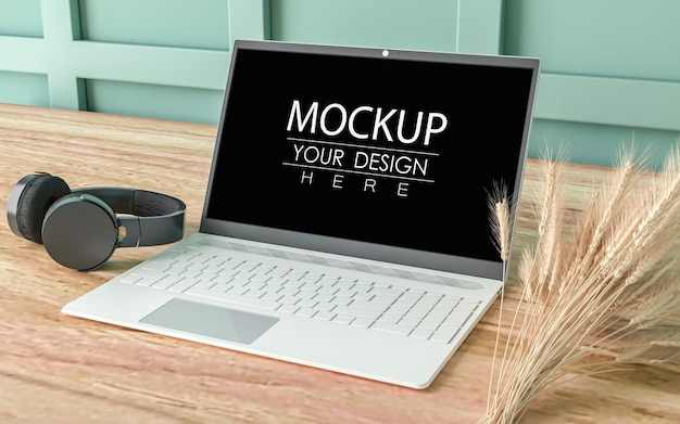 Laptop on desk in work space psd mockup