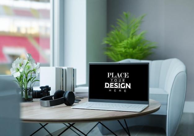 Laptop on desk in workspace mockup