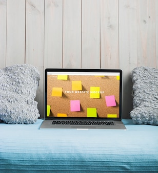 Laptop mockup on bed