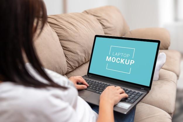 Laptop mockup in the girl's lap