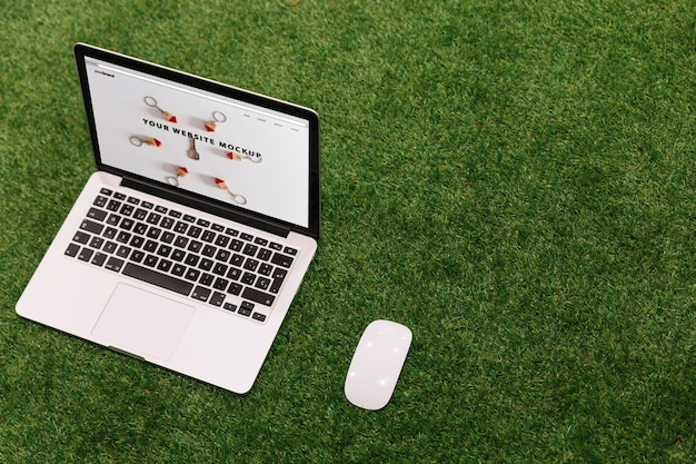 Laptop mockup on grass