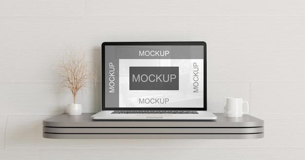 Laptop mockup on the gray metal wall desk
