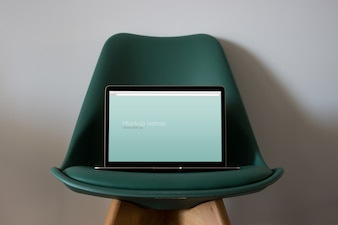 Laptop mockup on chair