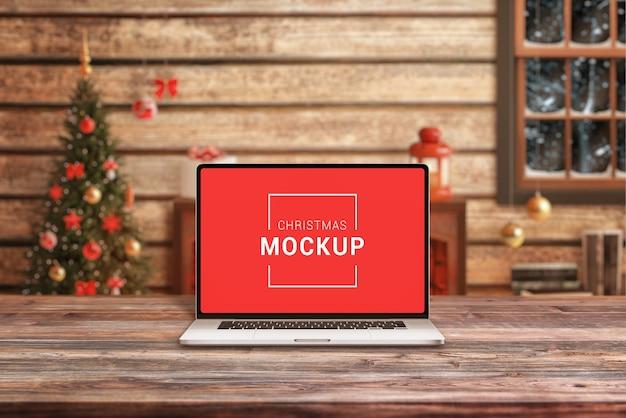 サンタクロースの机の上のラップトップのモックアップ