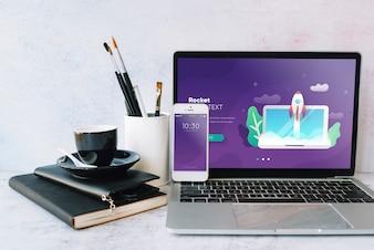 Laptop mockup on workspace table