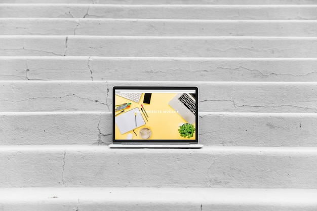 Laptop mockup on stairs