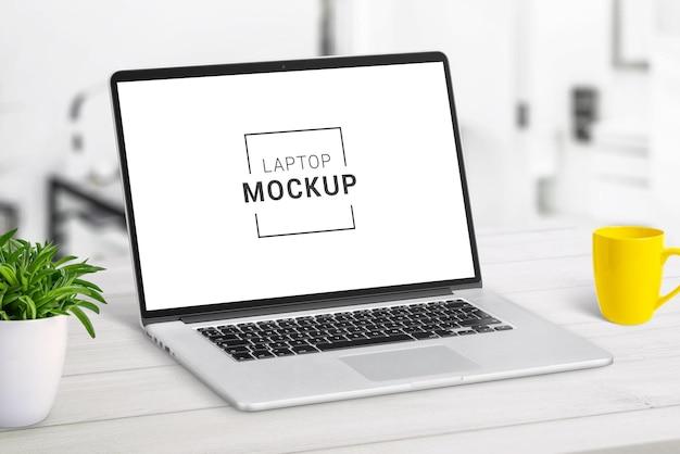 Laptop mockup on white desk closeup