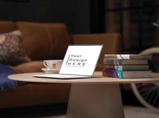 Макет ноутбука с кофе и книгами на макете круглого стола
