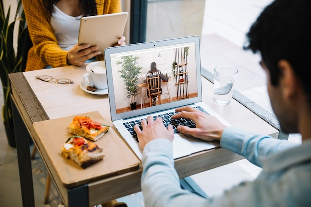 Laptop mockup with couple working