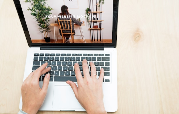 Laptop mockup with woman working at home