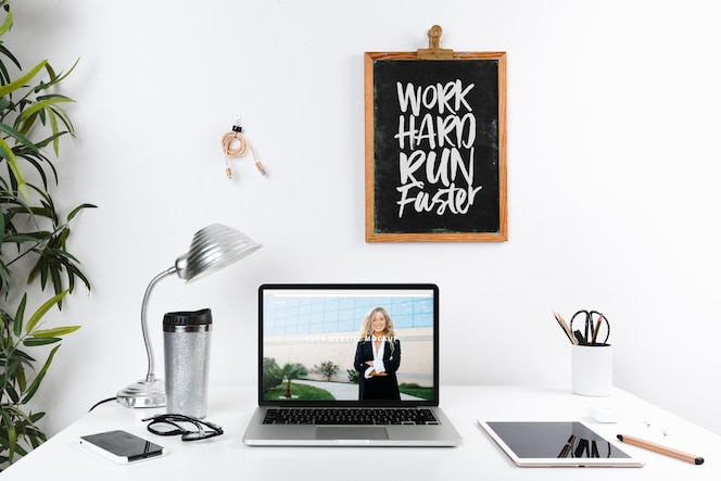 Laptop mockup with workspace composition