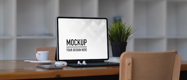 Laptop mockup on wooden table in co working space