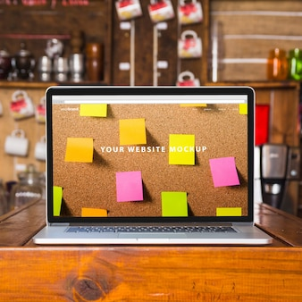 Laptop mockup on wooden table