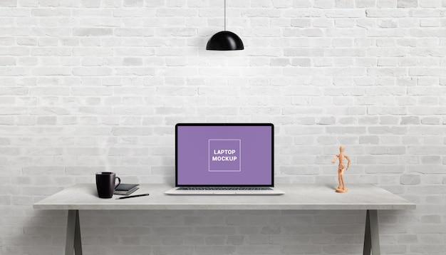 Laptop mockup on work desk