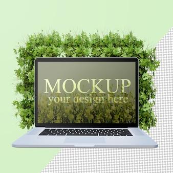 花のバケツとラップトップ画面のモックアップの正面図