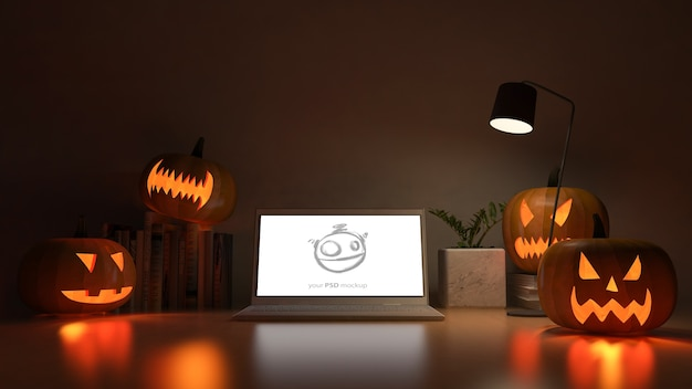 Laptop screen mockup with 3d rendering image of working table with pumpkin head