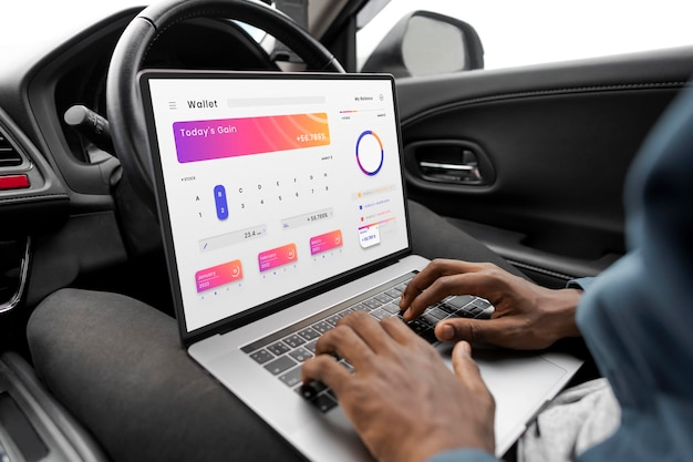 Laptop screen mockup with online banking app in a self driving car psd