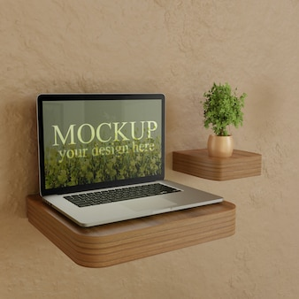 Laptop screen mockup on wooden desk with plant