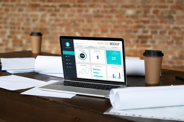 Laptop on table and paperwork Free Psd
