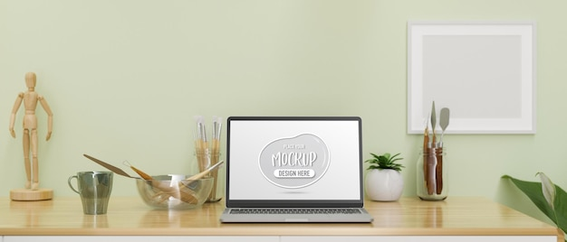 Laptop with mockup screen on artist workspace with tools and decorations 3d rendering