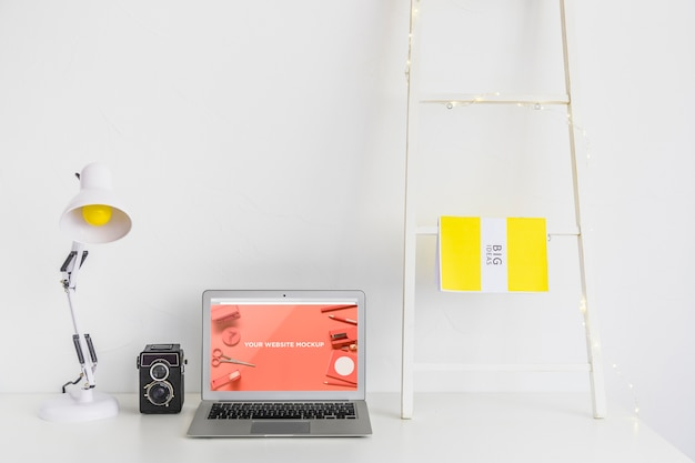 Laptop with mockup screen in clean and tidy workspace. education theme