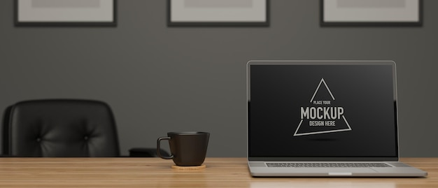 Laptop with mockup screen and cup on wooden table in meeting room