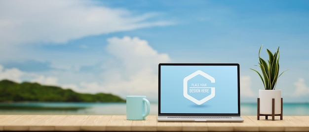 모형 스크린 머그와 화분이있는 노트북