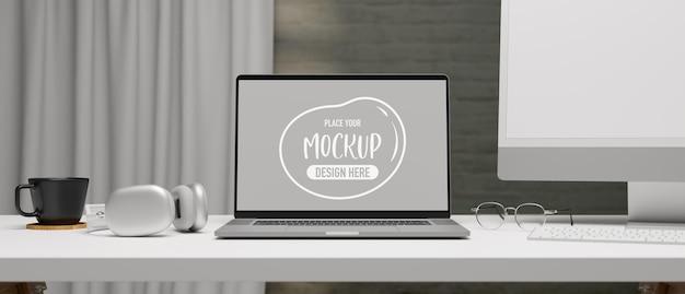 Ноутбук с макетным экраном на компьютерном столе с аксессуарами и принадлежностями 3d-рендеринг