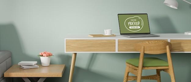 Ноутбук с макетным экраном на деревянном столе в стильной комнате домашнего офиса 3d-рендеринга