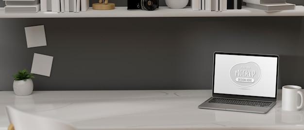 Laptop with mockup screen on the table in home office desk 3d rendering