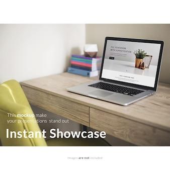 Laptop on wooden desktop mock up