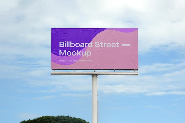 Large billboard mockup on blue sky with clouds