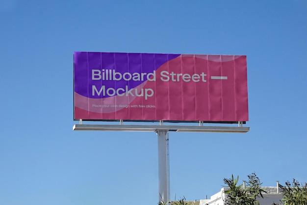 Large billboard mockup on clean blue sky
