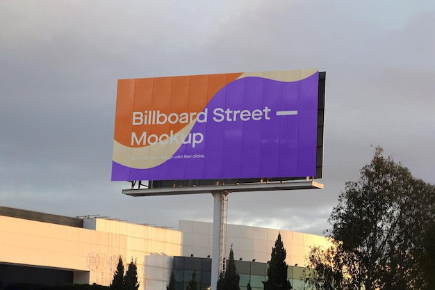 Large billboard mockup on cloudy sky