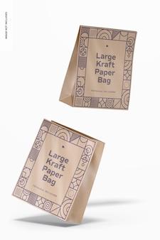 Мокап больших пакетов из крафт-бумаги, падающий