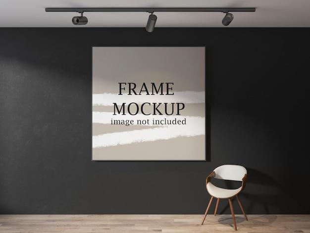 Large square frame mockup on black wall