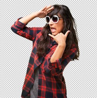 Latin girl doing a call gesture