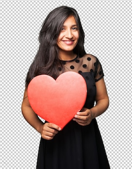 Latin woman holding a heart shape