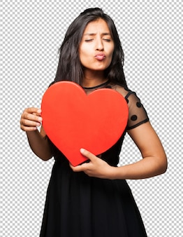 Latin woman holding a heart shape