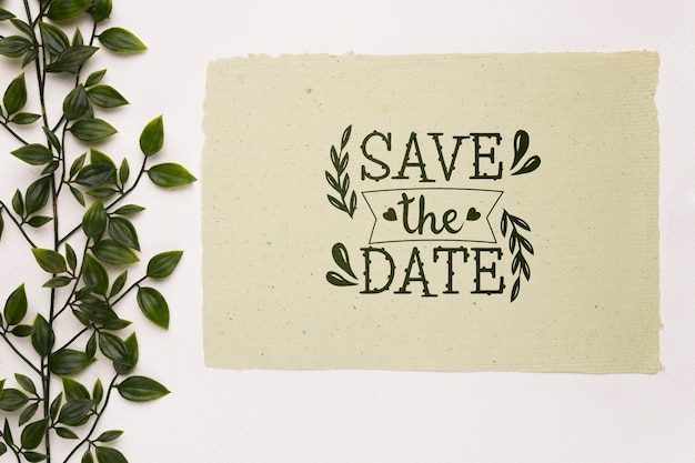 Leaves on branches save the date mock-up