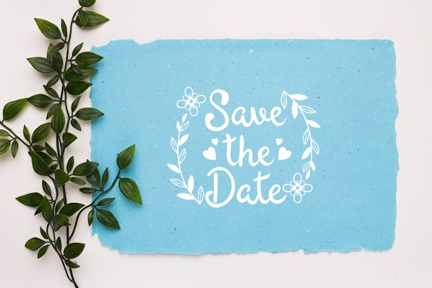 Leaves with blue save the date mock-up