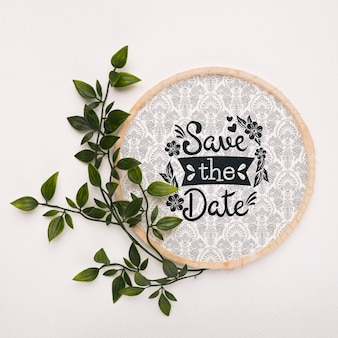 Leaves with circular frame save the date mock-up