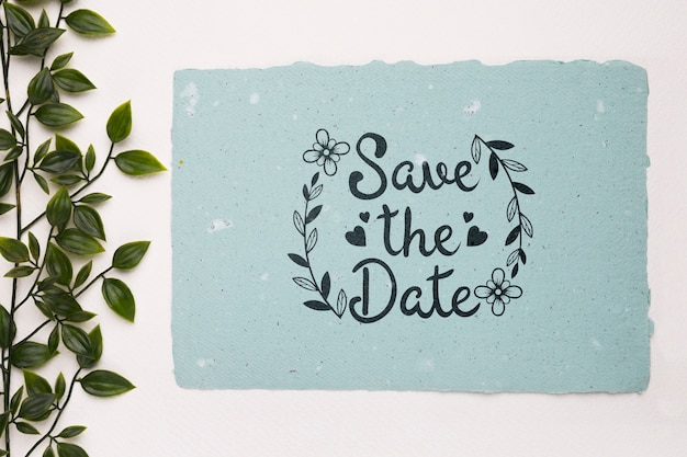 Leaves with save the date mock-up