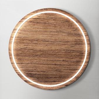 Led framed on round wooden background mockup