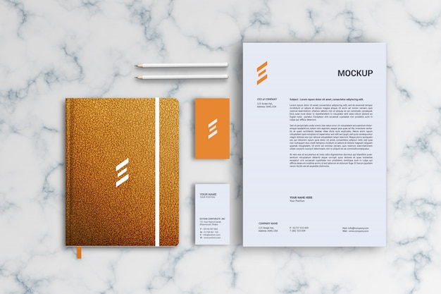 Фирменный бланк, визитная карточка и кожаный макет для ноутбука